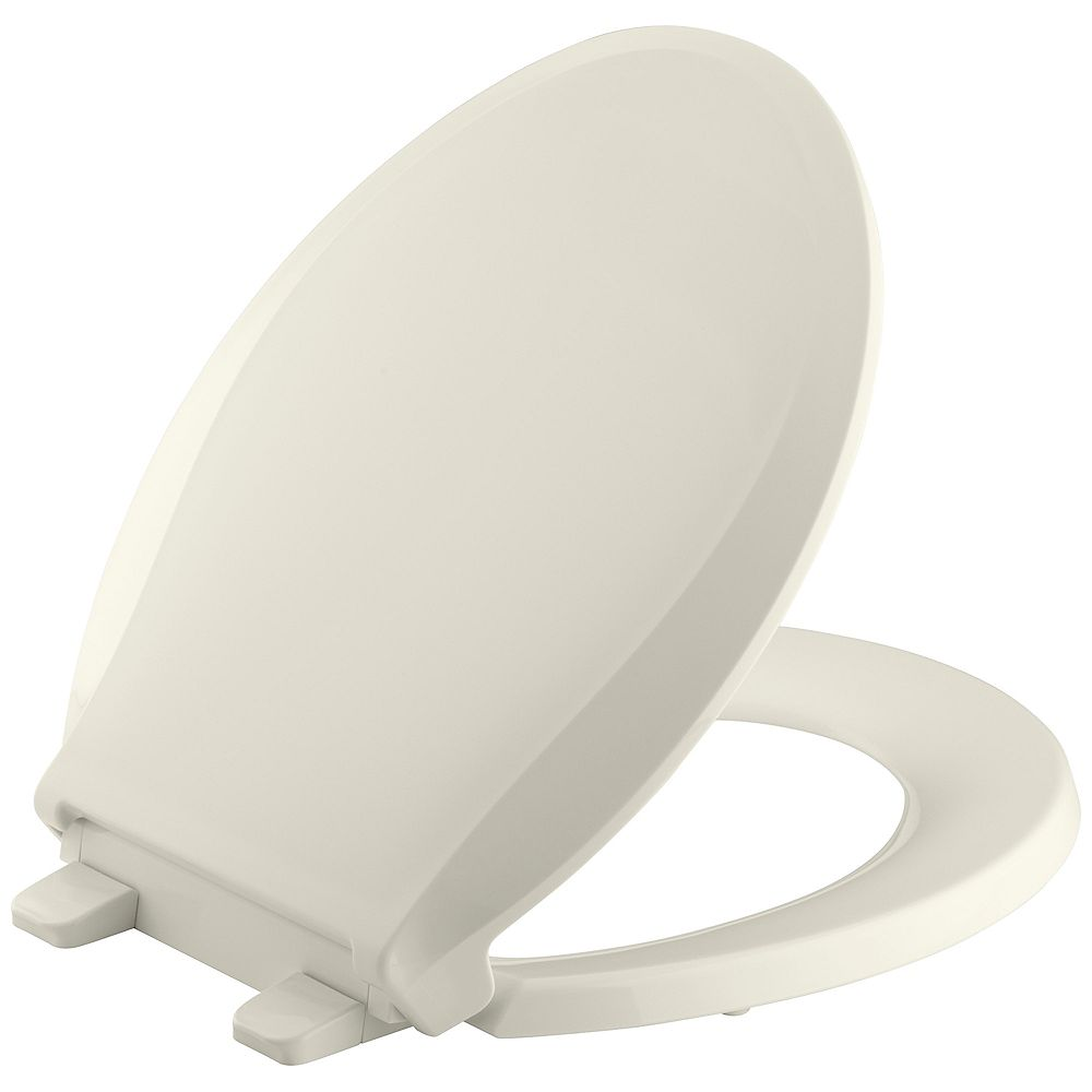 KOHLER Cachet Quiet-Close Round Front Closed-Front Toilet Seat with Grip-Tight Bumpers in Biscuit