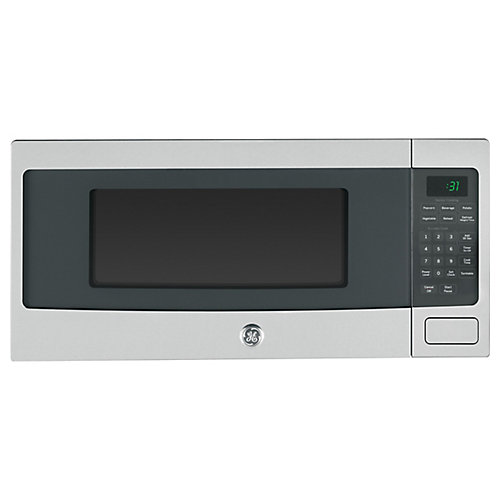 1.1 cu. ft. SpaceMaker Microwave Oven in Stainless Steel