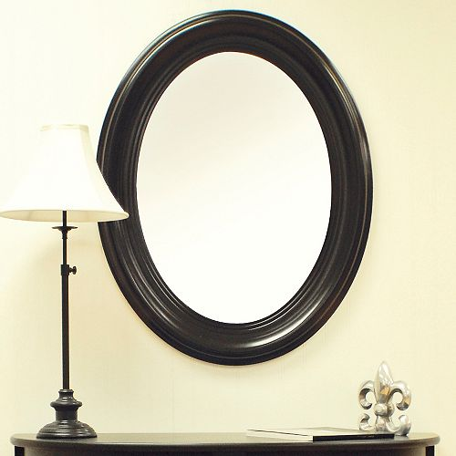 Miroir ovale, noir ancien