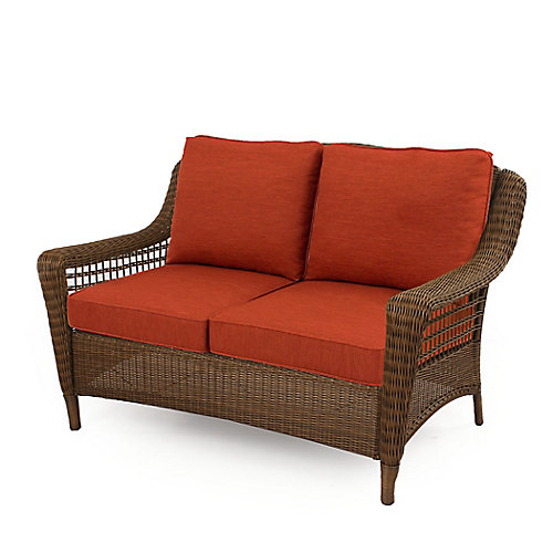 Causeuse en osier brun Spring Haven avec coussin orange