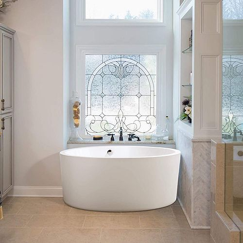 Freestanding acrylic bathtub with polished chrome round overflow and pop-up drain. 6810