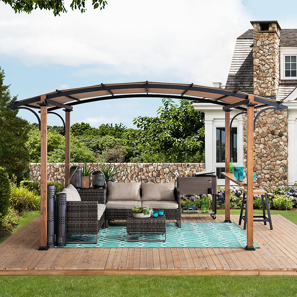 Sunjoy Alamo 10 ft. x 7.5 ft. Steel Arched Pergola with Natural Wood Looking and Tan Shade