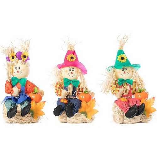 Set of 3 Garden Scarecrows Sitting on Hay Bale