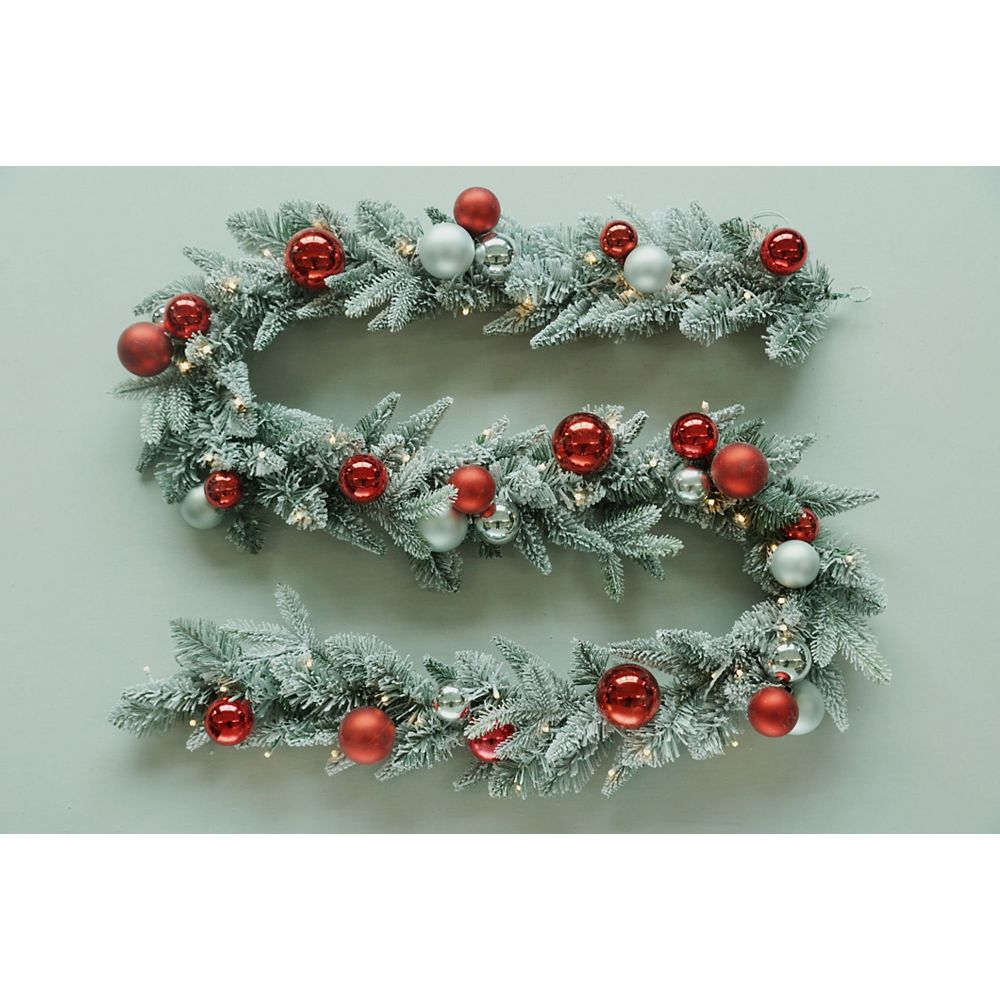 Home Accents Holiday 9 ft. Battery Operated 50 Warm White LED Pre-Lit Flocked Pine Christmas Garland with Timer
